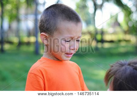 little boy crying with tears outdoor maother calming