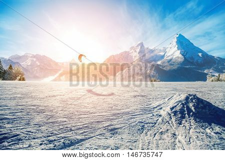 Young Men, Skiing On Frozen Lake In The Mountains, In The Rays Of The Rising Sun, In Winter
