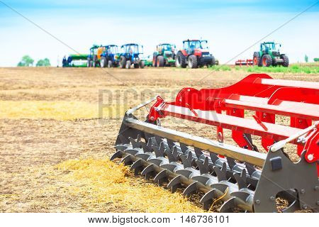 Agricultural cultivator close-up on the ground farm equipment