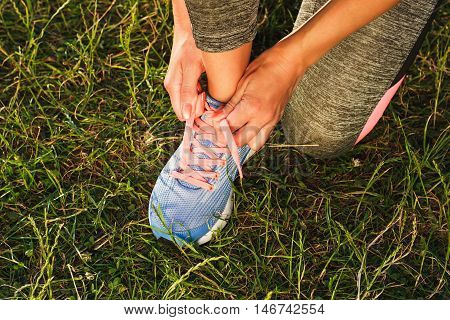 Body Part: Sportswoman Ties Shoelaces On Her Shoes