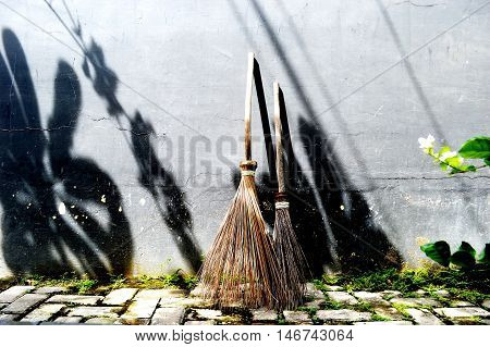 A Broom.It's Asian Broom.It's Brown And Traditional.