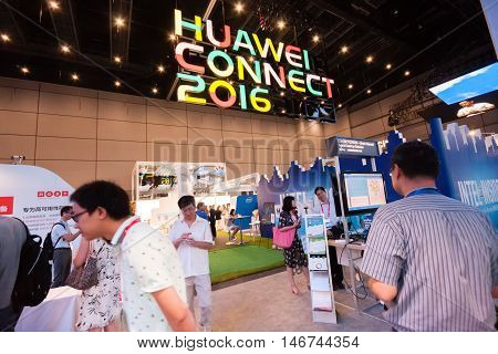 SHANGHAI CHINA - SEPTEMBER 2 2016: Attendees of Huawei Connect 2016 information technology conference at Expo Center exhibition hall in Shanghai China on September 2 2016.