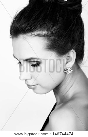 close-up portrait of a sexy beautiful woman in little black fashion dress. black and white.