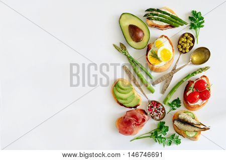 Sandwiches on a light background or assorted canapes top view