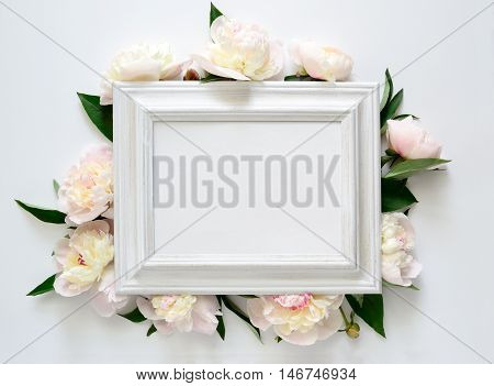 Wedding invitation or bridal shower invitation white wooden frame decorated with flowers blank space for a text