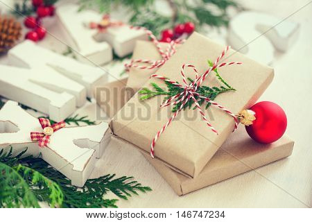 Christmas festiv setting with a stack of presents wrapped with natural colored paper and traditional Xmas twine retro stylized photo