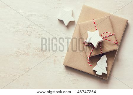 Christmas or New Year presents on a wooden natural warm white surface view from above retro stylized photo