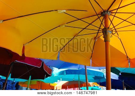 Colorful umbrellas in cafe near the beach