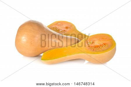 whole and half cut fresh squash butternut on white background