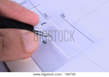 Unterzeichnung eines Schecks