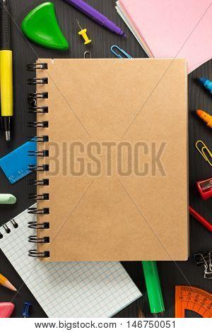 school supplies on black wooden background