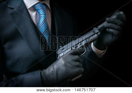 Mafia Man Or Racketeer Holds Pistol With Silincer In Hands. Low