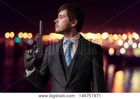 Secret Agent Or Assassin Is Holding Gun With Silencer In Hand At