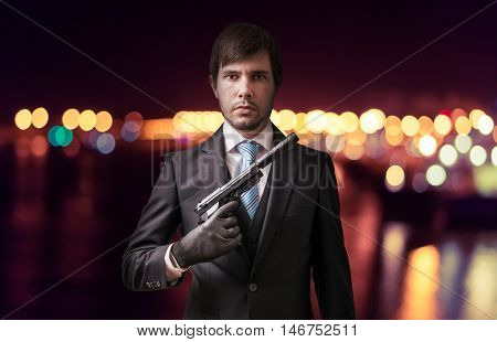 Agent Or Spy With Gun At Night. Crime Concept.