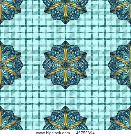 Seamless textile pattern. Applique of floral mandala prints on plaid check background. Color palette: shades of aquamarine green & yellow.