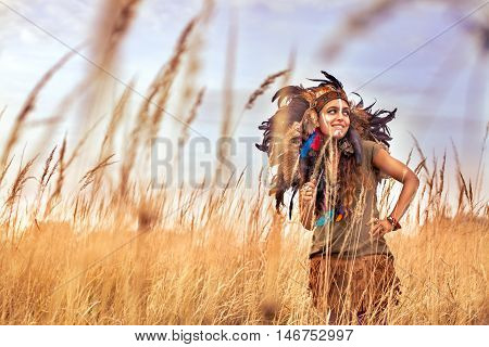Native American Indian Girl Dressed In National Clothes Smile With White Teeth In Field