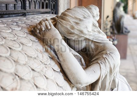 More than 150 years old statue. Cemetery located in North Italy.