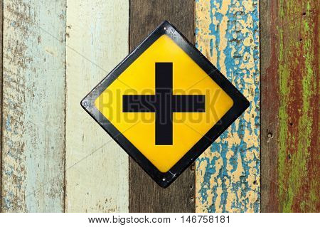 Crossroads sign plate on wood texture wall