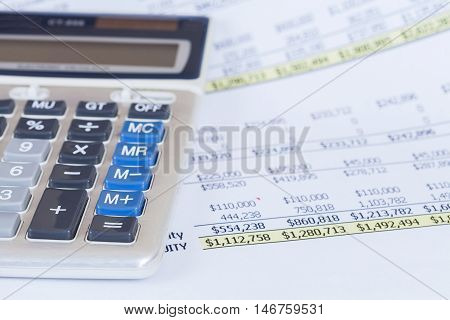 calculator and business diagram document on background