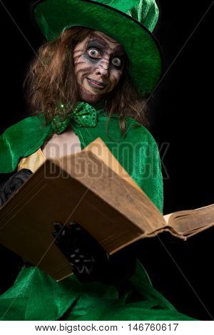 Funny Goblin Girl Is Reading From A Book, Concept Fairytales And Myth