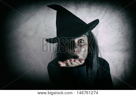 Halloween witch. Low key. Computer added dirt, scratches, grain and vignette.