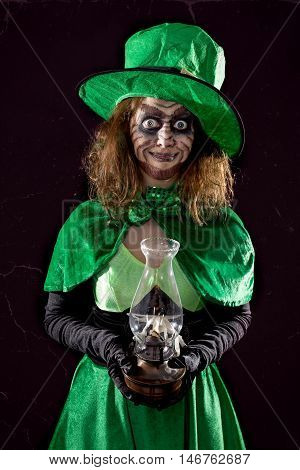 Leprechaun Girl With A Portable Light, Black Background, Concept St. Packtrick´s Day