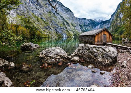 Boat garage in middle of the lake. Enchanted Lake Obersee in the Bavarian Alps. The concept of active tourism and ecotourism