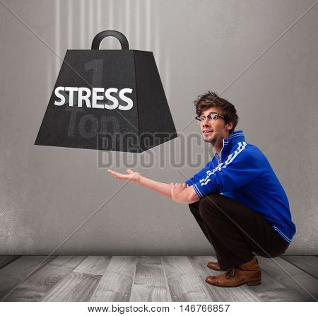 Handsome young boy holding one ton of stress weight
