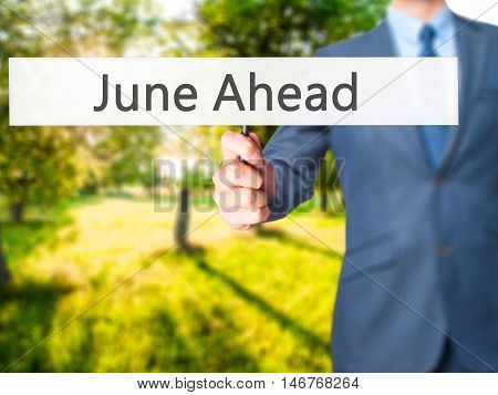 June Ahead - Businessman Hand Holding Sign