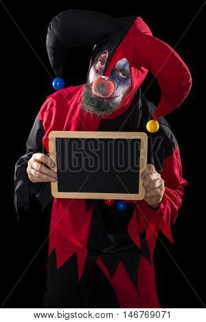 Sadly Clown Holding A Slate With Copyspace, Black Background