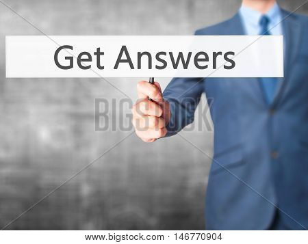 Get Answers - Businessman Hand Holding Sign