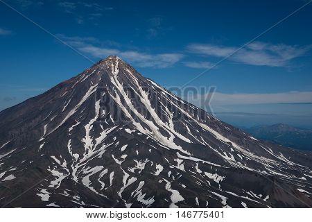 Top of Koryaksky Volcano seen from Avachinksy Volcano, Kamchatka, Russia