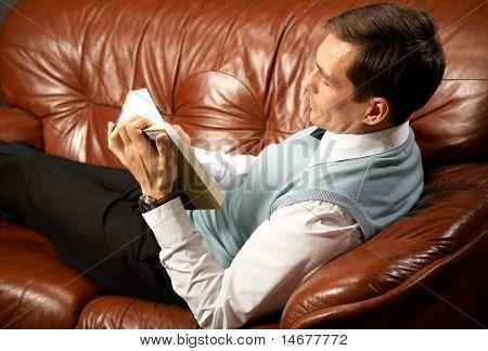 man reads book