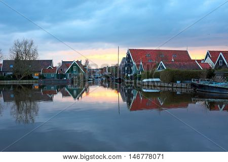Typical medieval dutch houses in the countryside from the Netherlands at sunset