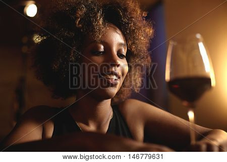 Young Self-confident Attractive Dark-skinned Woman With Afro Hairstyle Wearing Black Elegant Dress,