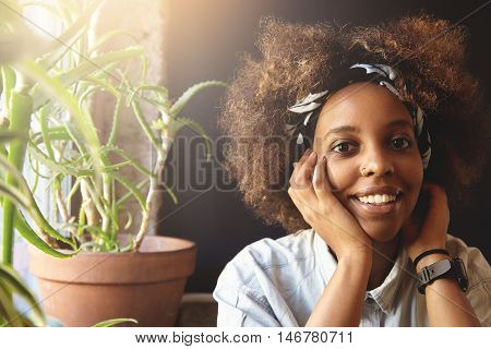 Fashionable Student Girl With Afro Haircut Wearing Denim Jacket, Bandana And Facial Piercing, Lookin