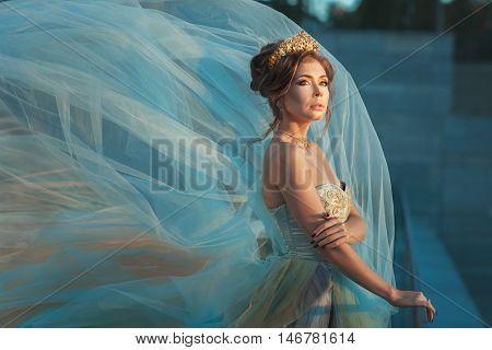 Young girl Queen in a fluttering dress.