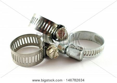 Three hose clamps. Closeup with white background