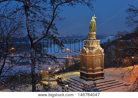 Illuminated bronze statue of Saint Vladimir in Kiev. All space is powdered with snow.