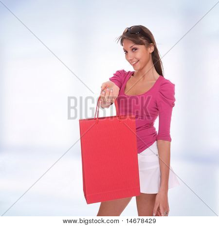 Portrait of young cute shopaholic blue on pink studio background