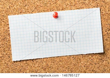 Blank piece of graph paper  pinned to a cork notice board