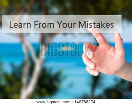 Learn From Your Mistakes - Hand Pressing A Button On Blurred Background Concept On Visual Screen.