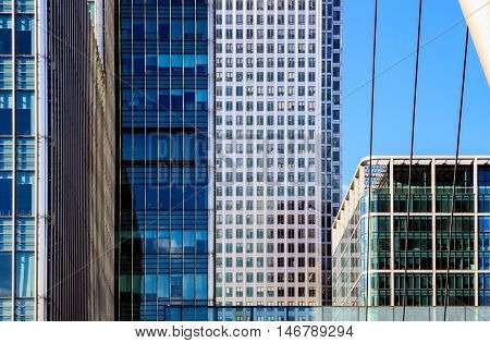 Office Buildings and South Quay footbridge in Canary Wharf financial district of London