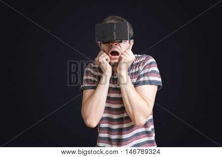 Man Is Wearing 3D Virtual Reality Headset And Is Scared Of Somet