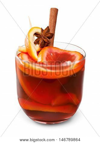 Hot red mulled wine for winter and Christmas with orange slice, anise and cinnamon sticks isolated on white background, closeup
