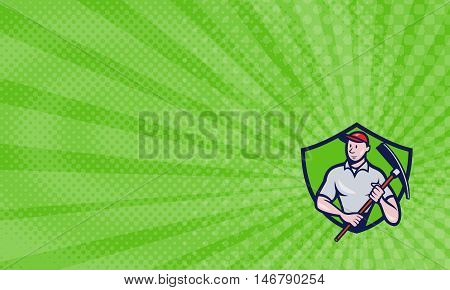 Business Card showing Illustration of a construction worker looking to the side holding pickaxe viewed from front set inside shield crest on isolated background done in cartoon style.
