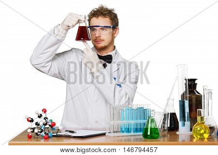 man with test tubes in a chemistry lab