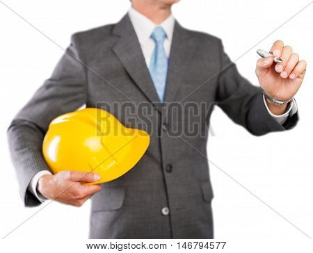 man holding a helmet and a pen