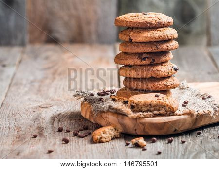 Chocolate chip cookies on burlap and rustic wooden table