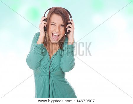 Girl Listening to Music over abstract background